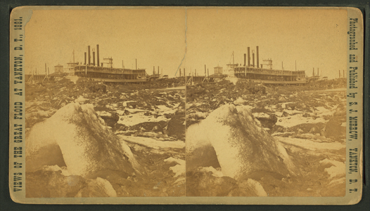 "Steroscopic view card showing ""Blasting ice with dynamite from in front of steamer on the ways, by Stanley J. Morrow"" ~ A view of Yankton's riverfront after the flood of March 1881. Blasting ice with dynamite from in front of steamer on the ways, by Stanley J. Morrow.png"