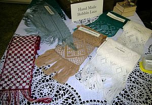 Bobbin lace - Contemporary handmade woollen bobbin lace articles, Wool Expo, Armidale NSW. Pale green lace is made of 2 ply wool.
