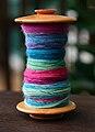 Bobbin with colourful wool.jpg
