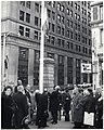 Boston Director of Civil Defense Charles W. Sweeney and unidentified men raising flag outside The Boston Five Cents Savings Bank Building on Province Street (11191904693).jpg
