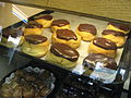Boston cream doughnuts in display case, November 2007.jpg