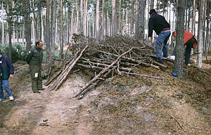 Survival skills - Civilian pilots attending a Survival course at RAF Kinloss learn how to construct shelter from the elements, using materials available in the woodland on the north-east edge of the aerodrome.