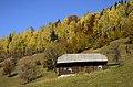 Cabin on the mountain side (Unsplash).jpg