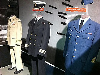 Uniforms of the Canadian Armed Forces - Historical distinctive service uniforms for the Canadian Army, Royal Canadian Air Force, and the Royal Canadian Navy on display. Each service has a distinct dress uniform, differentiated by colour, cut, and headdress.