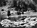 Caravan crossing a river (3948802144).jpg