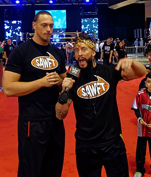 Enzo Amore - Amore (right) with Colin Cassady at WrestleMania Axxess in March 2015