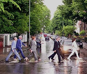 Carolyn Porco - Porco (at right) re-enacting the famous Beatles photograph at Abbey Road with the other members of the Cassini Imaging Team.