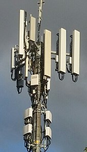 Group of typical cellular antennas, shown at the top of the tower