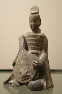A Sui Dynasty (581–618) terra cotta pipa-player in a suit of armor