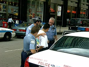 Chicago police making an arrest in public.