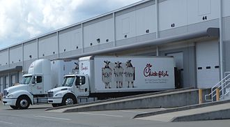 "Chick-fil-A - Chick-fil-A trucks displaying the ""Eat Mor Chikin"" slogan"