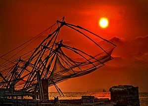 Fishing in India - A fisherman net in Kerala. In some Indian states, these nets are commonly called Chinese fishing nets.