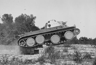 T3E2 tank with Christie suspension crossing an obstacle during tests in 1936 Christie T3E2 tank LOC.hec41005.jpg