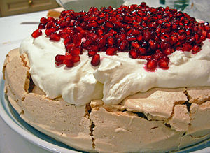 A homemade pavlova decorated with pomegranate ...