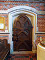 Church of the Holy Trinity - nave door interior - East Grimstead, Wiltshire, England.jpg