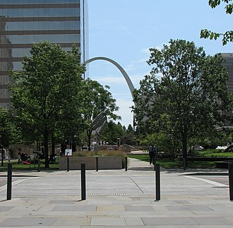 Citygarden - As one looks east across Ninth Street, the Gateway Arch is visible past Citygarden.
