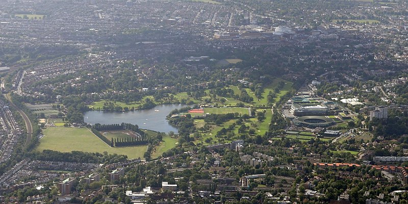 Aerial view of Wimbledon from the north in August 2015, with Wimbledon Park (left) and the All-England Club, the venue for the Wimbledon Championships (right). Cmglee London Wimbledon aerial.jpg
