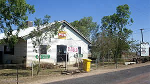 Corfield, Queensland - The historic Corfield Pub. A sign promoting the Corfield Cup can also be seen.