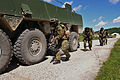 Croatian soldiers take cover beside a military vehicle as they enter a village during a raid as part of Immediate Response 2012 at the Slunj Training Area, Croatia, June 5, 2012 120605-A-KH850-016.jpg