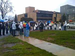 The Laramie Project - Group preparing to block from view members of the Westboro Baptist Church protesting a production at Daemen College