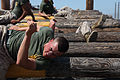 Defense.gov News Photo 110627-M-ZG301-125 - U.S. Marine Corps Cpl. Joshua Thomas a corporal s course student at Marine Corps Air Station Miramar weaves over and under logs while completing.jpg