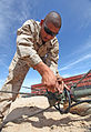 Defense.gov News Photo 120710-M-PF875-003 - Cpl. Isac Pena a radio operator with 9th Communication Battalion assembles a retransmission antenna during Large Scale Exercise-1 during annual.jpg