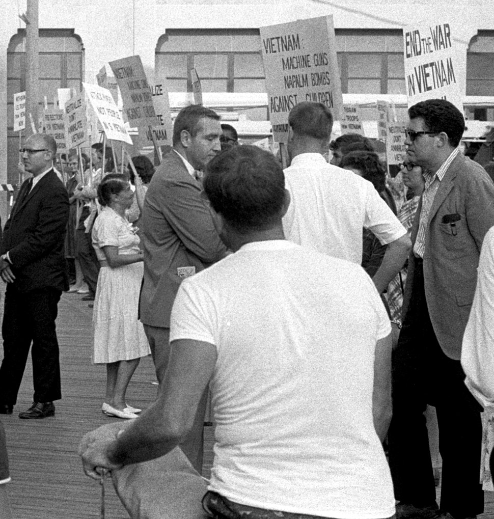 Demonstrators against the war in Vietnam holding signs on the boardwalk during the 1964 Democratic National Convention (cropped1)