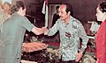 Director General of Radio, Television and Film Soemadi receiving gift, Festival Film Indonesia (1982), 1983, p58.jpg