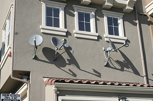 DBS satellite dishes installed on an apartment complex. Dishing out the truth.JPG