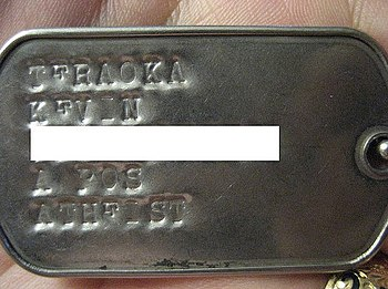 English: Military dog tags with religious (bel...