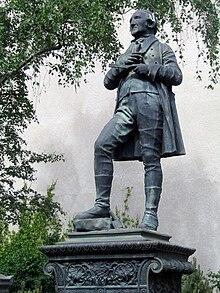 Statuette auf Schadows Grab (Quelle: Wikimedia)