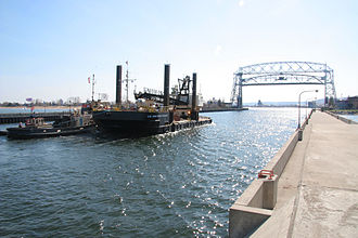 Duluth Ship Canal - US Army Corps of Engineers barge in canal, looking towards Duluth