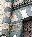 Duomo di prato, portale sud, macchia rossa della mano di musciattino.JPG