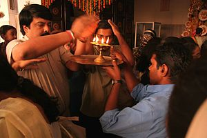 Worship in Hinduism - Taking Aarti blessing.