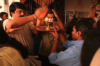 Aarti - Taking Aarti blessing during a Durga puja celebration.