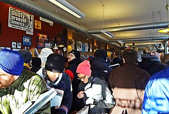 Record sales - A crowd buying records in the Dusty Groove store during the Record Store Day, April 2014.