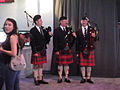 E3 Expo 2012 - Disney booth Brave bagpipers (7641060736).jpg