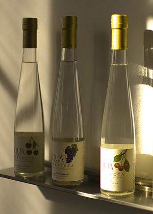 Eau de vie - Three bottles of eau de vie. The flavors are  framboise (raspberry), zinfandel grape, and cherry.