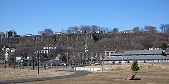 Edgewater, New Jersey - Community Center with Little League field and track in foreground. Palisades Cliff in background.