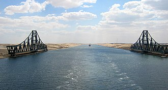 Swing bridge - El Ferdan Railway Bridge in Egypt; the longest swing bridge in the world, runs from the east of the Suez canal to the west into Sinai. It is left open most of the time to allow sailing ships to pass in the canal, only closing during the passage of trains.