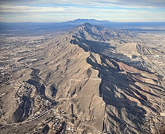 Franklin Mountains (Texas) - Aerial view of the Franklin Mountains from the south, with El Paso's Scenic Drive at the bottom, and New Mexico's Organ Mountains on the horizon in the distance