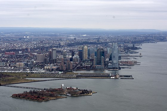 Mid-December 2014 aerial view of the area. In the foreground is Ellis Island, and behind it is Liberty State Park and Downtown Jersey City. Ellis Island photo D Ramey Logan.jpg