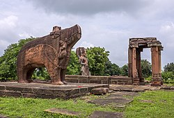 Eran - Monolithic Varaha and ruined Vishnu Temple in background.jpg