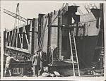 Erection of metal formwork on the southern platform of the Sydney Harbour Bridge, 1928 (8283768556).jpg