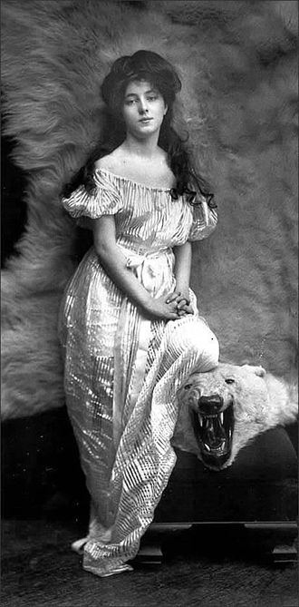1900s in Western fashion - Evelyn Nesbit, in this photograph taken in 1901, has some of her wavy hair swept up to the top of her head, with the rest of her hair flowing past her shoulders in curling tendrils.