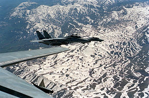 Operation Provide Comfort - As seen from the cockpit of a Fighter Squadron 41 (VF-41) F-14A Tomcat aircraft, a Fighter Squadron 84 (VF-84) Tomcat, background, and another VF-41 Tomcat fly in formation at an aerial refueling meeting point during Operation Provide Comfort, a multinational effort to aid Kurdish refugees in southern Turkey and northern Iraq.