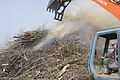 FEMA - 40021 - Equipment operator working on a smoking debris pile in Kentucky.jpg