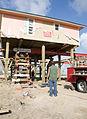 FEMA - 44203 - Cortractor raising a home in crystal Beach, TX.jpg