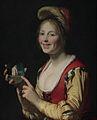 Femme montrant un objet obscène.JPG