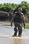 Fighting flood means getting wet 110624-F-WA217-305.jpg